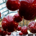 Giant red baubles in Covent Garden Apple Market.  Photo by Eugenie Absalom
